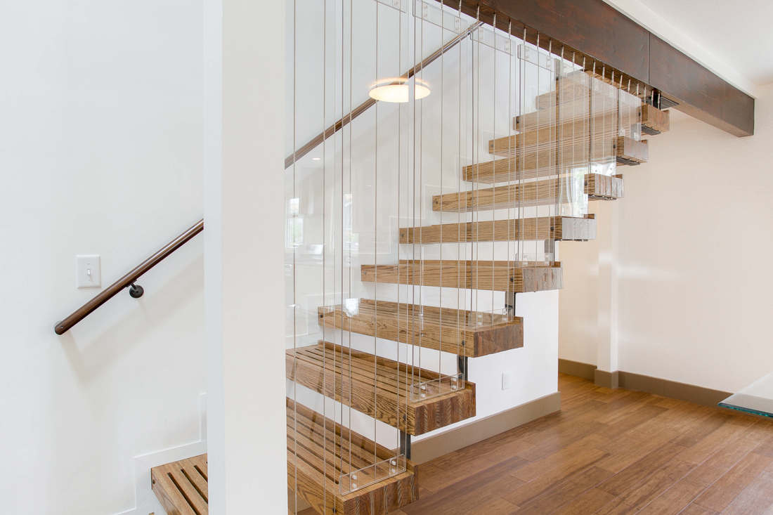27-Handcrafted-Open-riser-stairs-feature-Oak-and-Pine-risers-suspended-with-cables-from-exposed-LVL-1100x733.jpg