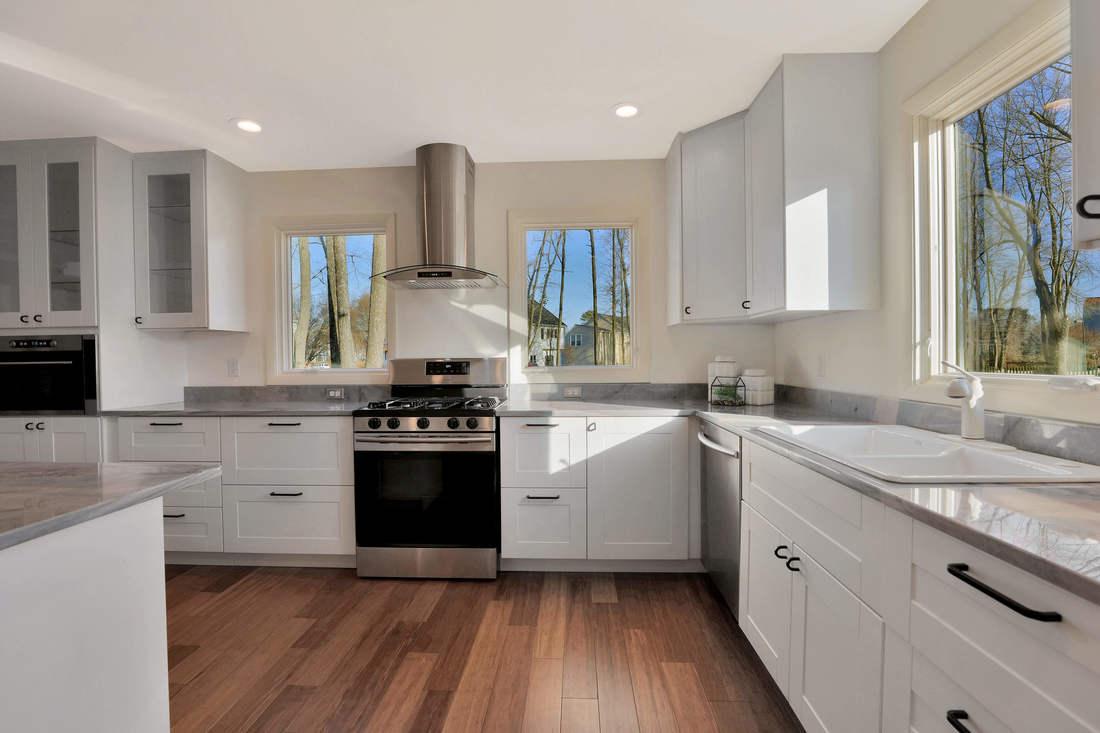 4-Bright-Sunny-Kitchen-Kohler-cast-iron-enamel-sink-Moen-faucet-inbuilt-garbage-disposal-cast-iron-handles-bamboo-flooring-ikea-cabinets-1100x733.jpg