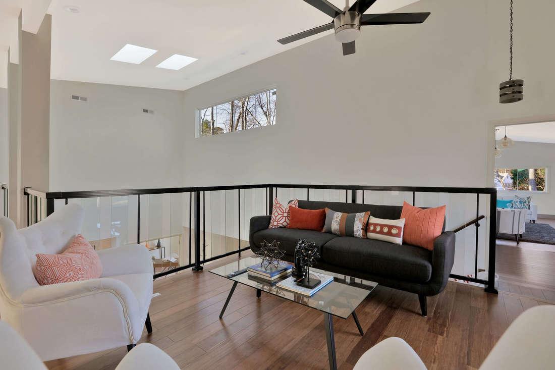 8-Family-deck-ample-daylight-skylights-glass-and-steel-handrails-bamboo-flooring-1100x733.jpg